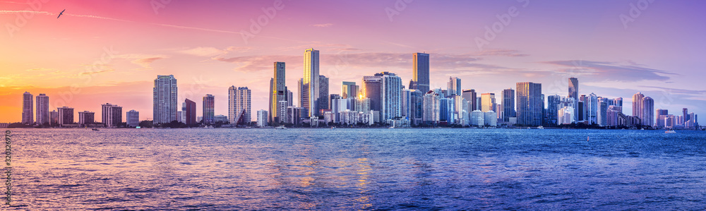 Fototapeta the skyline of miami while sunset