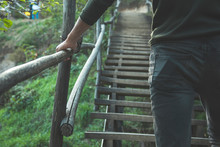 The Man Climbs The Wooden Stairs