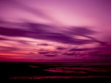 Magenta Tinted Sky Over A Pink...