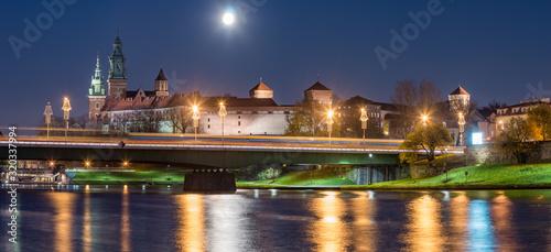 Krakow, Poland, Night panorama of Wawel Castle over Vistula river