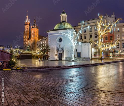 Krakow, Poland, Main Square, Sw Wojciech church and St Mary's church in the winter season, during Christmas fairs