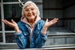 Happy mature woman standing outdoors stock photo
