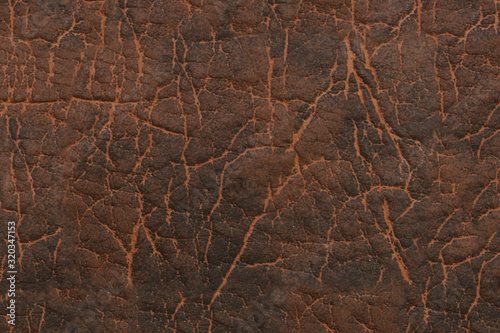 Fototapeta Brown faux leather. Textured surface with a pattern. obraz