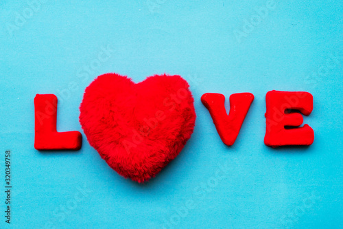The word Love is made up of red letters on a blue background. Canvas Print