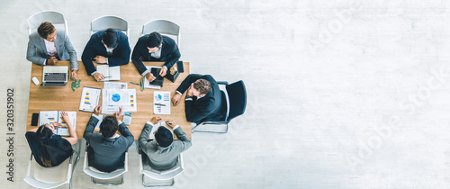 Top view on a group of businessman and businesswoman having a meeting and making a business commitment Wallpaper Mural
