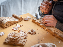 The Hands Of A Craftsman Carve...