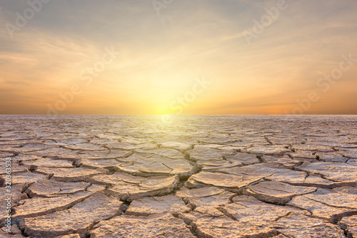 Landscape of soil drought cracked on sky sunset background Canvas Print