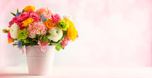 Beautiful Spring Flowers In Vase On White Wooden Table. Festive Concept With Copy Space.