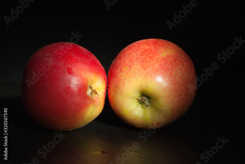Two apples on black. Diet food concept Canvas Print