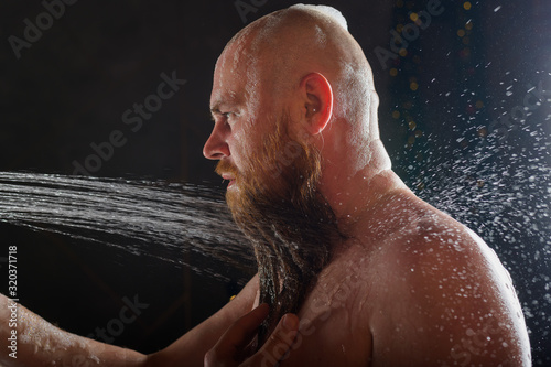 Vászonkép The bald guy takes a shower