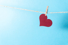 A Burgundy Heart Hanging On A ...