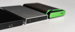 canvas print picture - three external hdd drives one the shelf, data backup storage