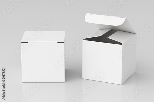 Fotografia Blank white cube gift box with open and closed hinged flap lid on white background