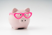 Piggy Piggy Bank In Glasses In The Shape Of Hearts, The Concept Of Loving Saving Money