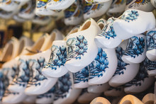 Traditional Souvenirs From Amsterdam - Fridge Magnets, Rows Of Delftware Porcelain, Dutch Style Houses, Dutch Wooden Clogs, Wooden Tulips And Windmill Miniature, Shop Window Store Front, Netherlands