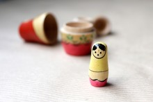Wooden Russian Matryoshka Dolls In Folk Style, Girls With Painted Dresses And Veiled Heads Covered With Babushka Shawl. A Little Girl Is Lost, Alone And Frightened