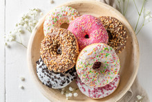 Homemade Donuts With Various Decoration On White Plate