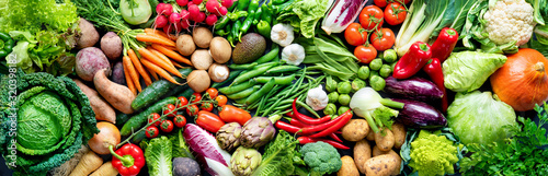 Food background with assortment of fresh organic vegetables - 320398182