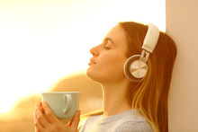 Relaxed Woman Listening To Mus...