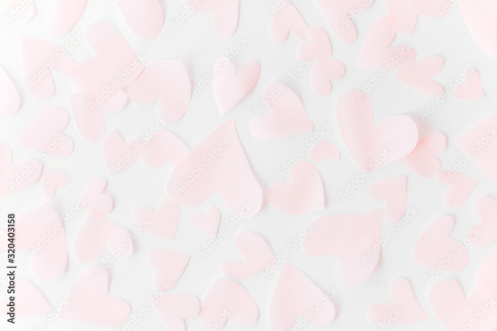 Fototapeta Cute pink pastel hearts on white paper  background. Flat lay. Happy valentines day. Pink paper heart cutouts on white backdrop, gentle image, greeting card. Valentine pattern