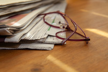 Newspapers And Glasses In Shal...