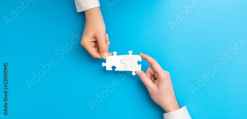 People holds in hand a jigsaw puzzle. Business solutions, success and strategy.