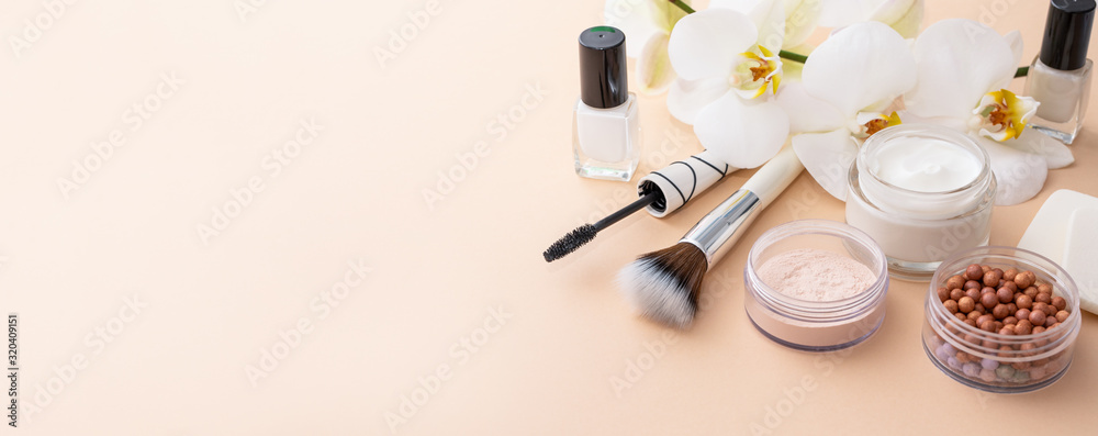 Fototapeta Beauty background with facial cosmetic products. Makeup, skin care concept.
