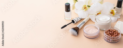 Beauty background with facial cosmetic products. Makeup, skin care concept.