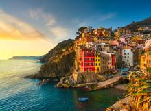 Riomaggiore Town, Cape And Sea Landscape At Sunset. Cinque Terre, Liguria, Italy