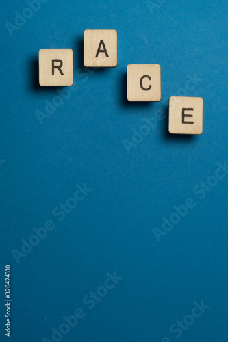 Fototapety, obrazy: Race: Square wooden letters on blue background