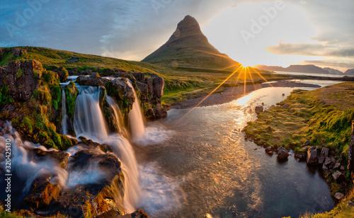 Beautiful landscape with sunrise on Kirkjufellsfoss waterfall and Kirkjufell mountain, Iceland, Europe.