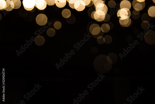 Obraz Abstract gold bokeh with black background - fototapety do salonu