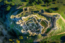 Aerial View Of The Hilltop Castle Ruin At Puebla De Almenara In Cuenca Spain With High Standing Walls Of The Inner Castle And A Bastioned Outer Courtyard