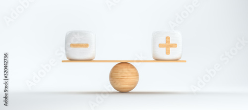 Foto wooden scale balancing cubes with plus and minus arguments
