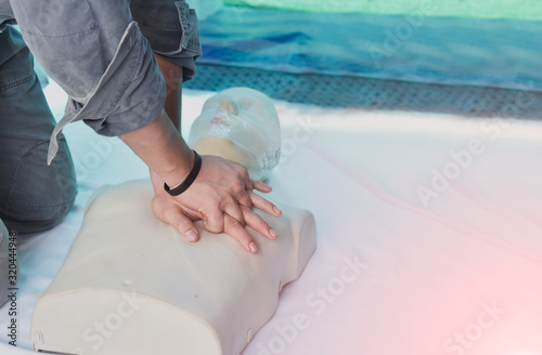 CPR training medical procedure – Demonstrating chest compressions on CPR in the class Canvas Print