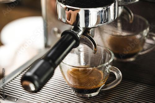 Coffee maker machine brewing espresso shot in clear glass cup фототапет