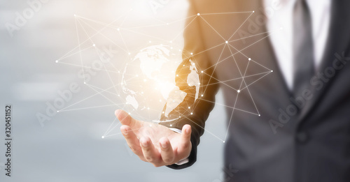 Businessman hand touching global network sphere connection communication and tec Fototapet