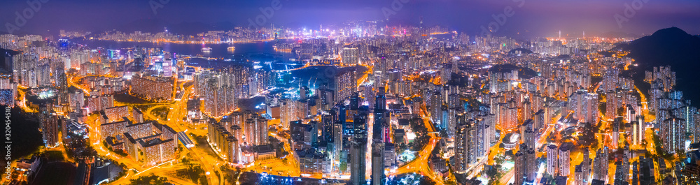 Fototapeta Night of Kowloon district, under the lion rock mountain, Hong Kong, cityscape