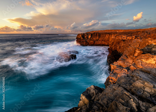 beautiful and dramatic sunset on a craggy rocky cliff, Jandia Peninsula, Fuertaventura