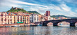 Leinwanddruck Bild Panoramic spring cityscape of Bosa town with Ponte Vecchio bridge across the Temo river. Amazing morning view of Sardinia island, Italy, Europe. Traveling concept background.