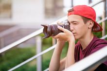 Teenage Boy Taking Photos Outd...