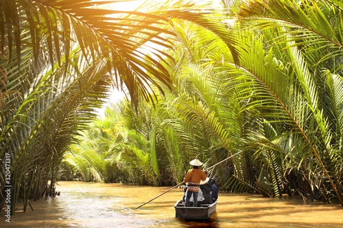 Fototapeta People boating in the delta of Mekong river, Vietnam obraz