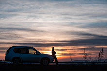 Man Standing Near Car On Sunset. Car Travel Concept