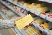 Female Hands Holding Cheese In...