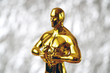 Leinwanddruck Bild - Hollywood  Golden Oscar Academy award statue on silver background. Success and victory concept.