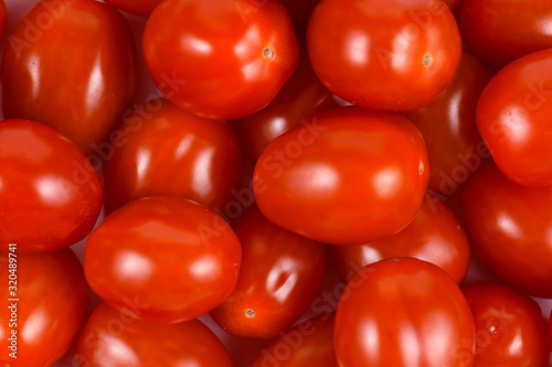 Top view of bunch of small red ripe  Roma or Plum cocktail tomatoes