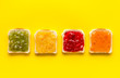 Leinwanddruck Bild - Toast with jam. Colorful set on yellow background top-down copy space