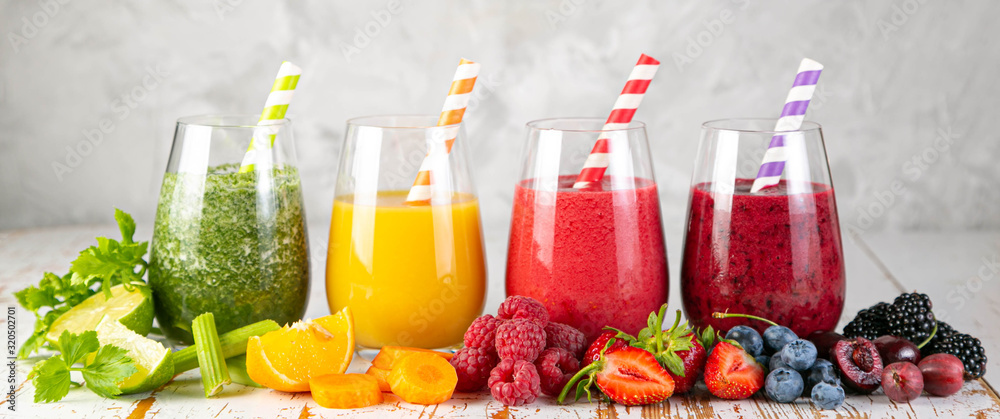 Fototapeta Selection of colorful smoothies and ingredients in glasses, rustic background