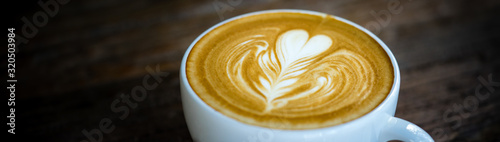 Closeup food and drink of hot coffee latte on dark table using as background food cover page concept Tableau sur Toile