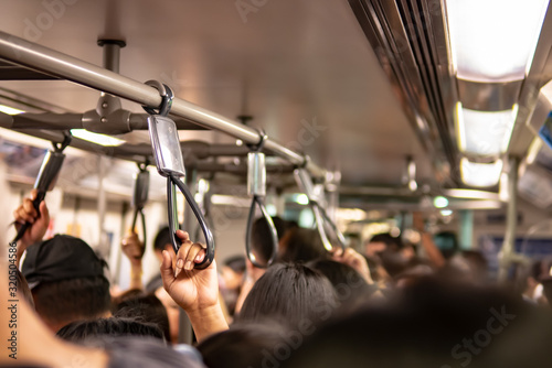 Crowd inside the train in rush hour - 320504586